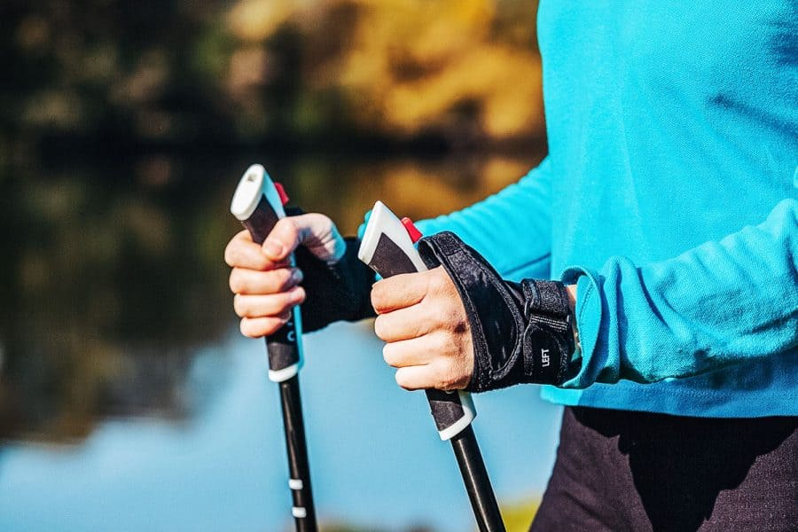 Closeup of hand holding nordic walking poles