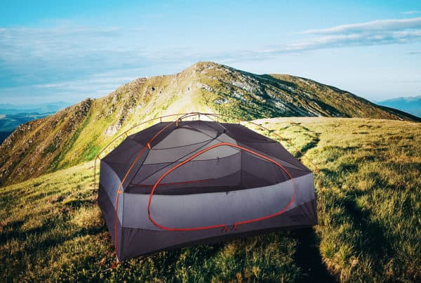 A tent on the top of a mountain