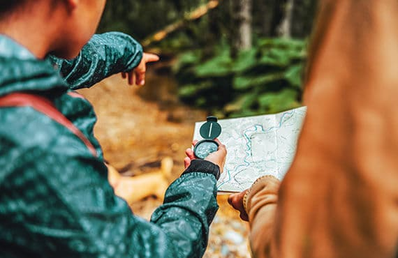 Hikers using the compass in interaction with a map
