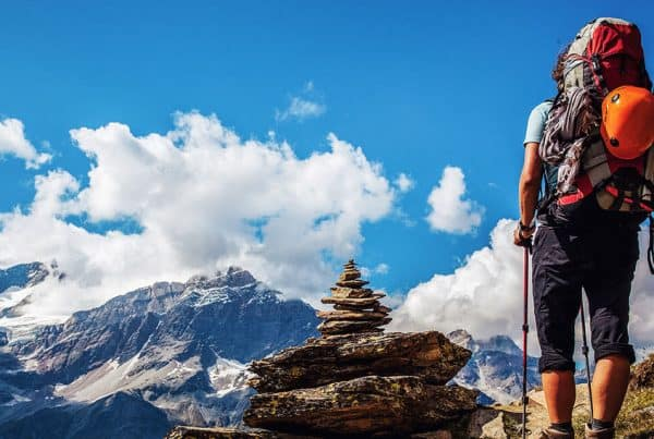 Hiker with backpack on a mountain trek