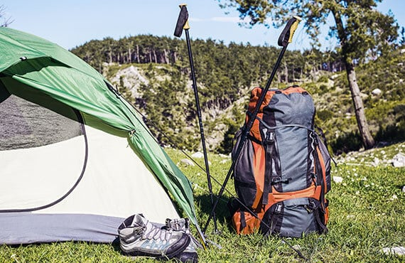 Camping with a backpack and a tent in the mountain