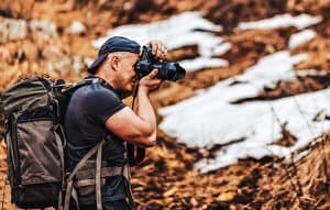 Hiker with camera catch good shot at nature