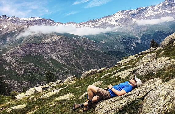 Hiker taking a rest during a mountain backpacking trip