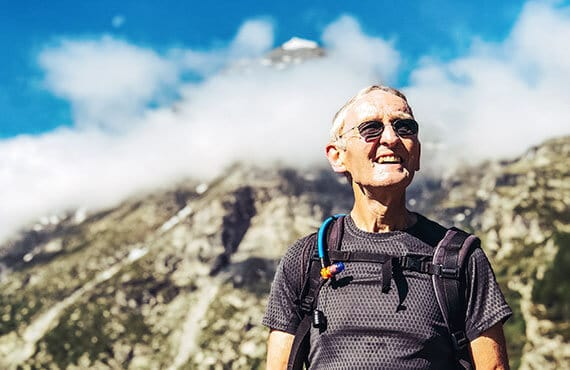 Portrait of smiling hiker during a mountain backpacking trip