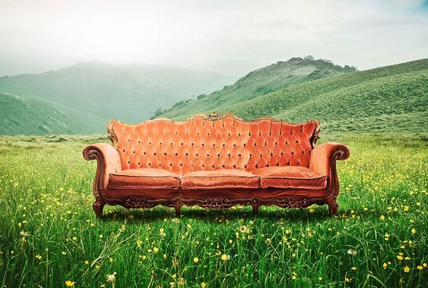 Scenic view of a sofa in the middle of a beautiful mountain landscape