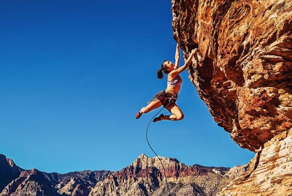 Rock climber clinging to a cliff