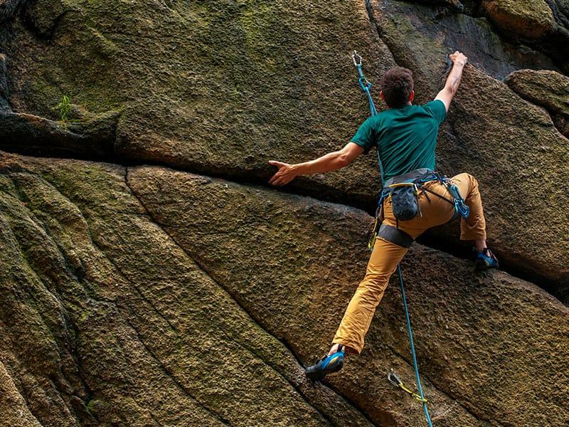 A man climbs a vertical wall